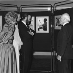 Ezra Rachlin explains his photograph exhibition of deaf children making music to Prince and Princess Michael of Kent.