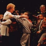 Deaf children embrace Ann at the end of the show
